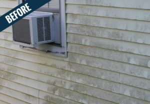 A 'before' image of residential siding showing years of dirt and mold.