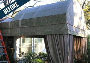 A 'before' image of a large awning with curtains showing years of dirt, mold, mildew and other environmental and biological contaminants.