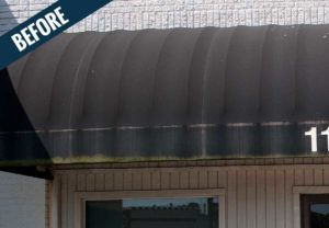 A'before' image of an awning showing the accumulation of dirt, mold and mildew.